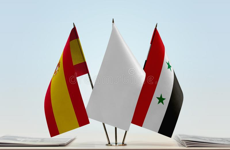 Flags of Spain and Syria. Desktop flags of Spain and Syria with white flag between royalty free stock images