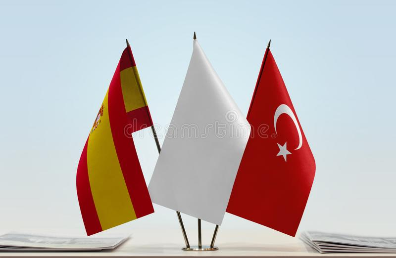 Flags of Spain and Turkey. Desktop flags of Spain and Turkey with a white flag in the middle vector illustration