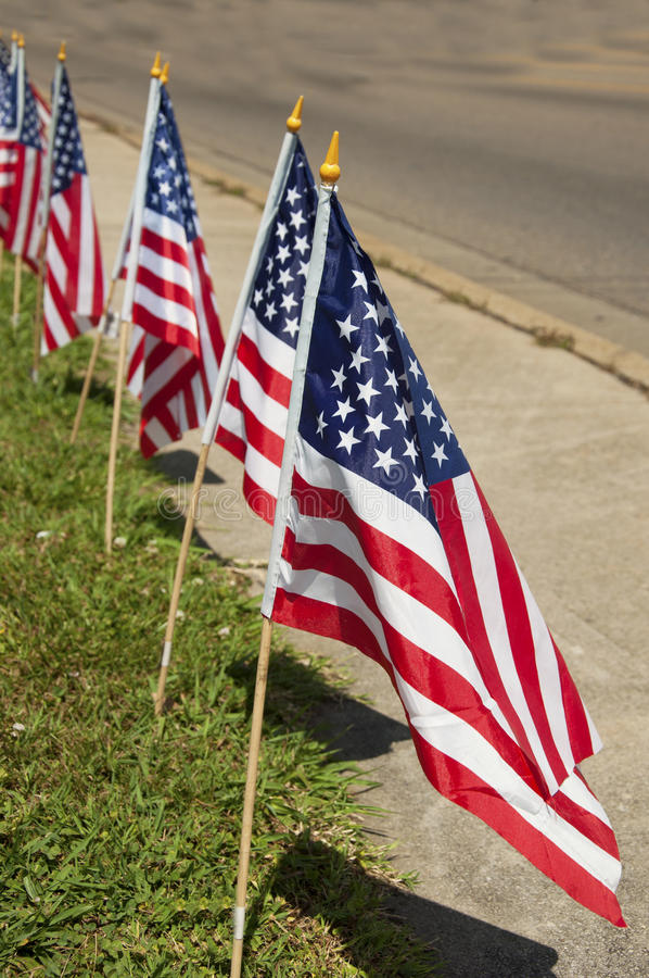 Download Flags Standing Along A Sidewalk Royalty Free Stock Photography - Image: 25458407