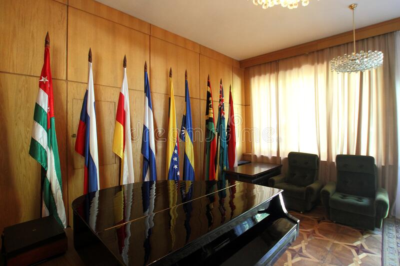 Flags of States are placed in the hall of the country house Stalin on the Ritsa lake royalty free stock images