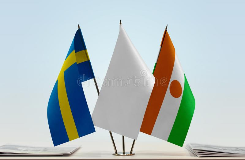 Flags of Sweden and Niger stock images