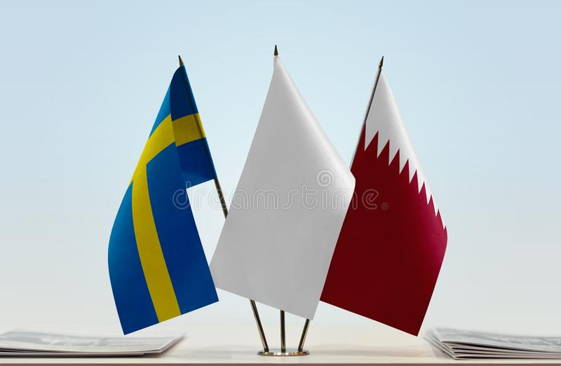 Flags of Sweden and Qatar royalty free stock photography