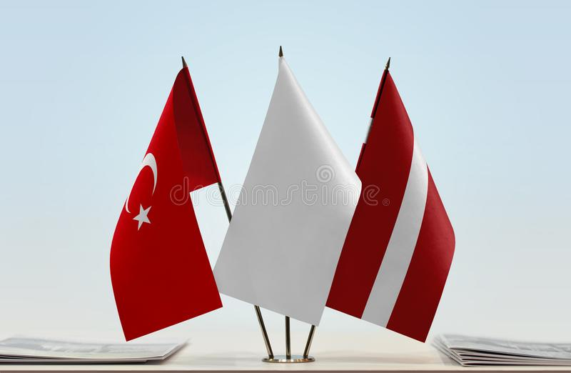 Flags of Turkey and Latvia. Desktop flags of Turkey and Latvia with a white flag in the middle stock photos