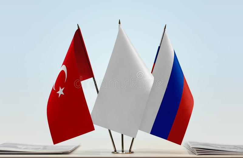 Flags of Turkey and Russia. Desktop flags of Turkey and Russia with a white flag in the middle royalty free stock photo