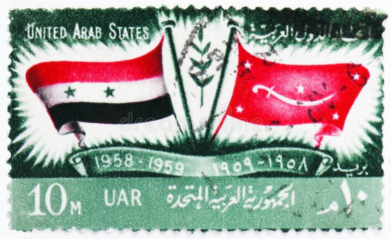 Flags of U.A.R. and Yemen, 1st Anniversary of Proclamation of United Arab States serie, circa 1959. MOSCOW, RUSSIA - JULY 25, 2019: Postage stamp printed in stock photography
