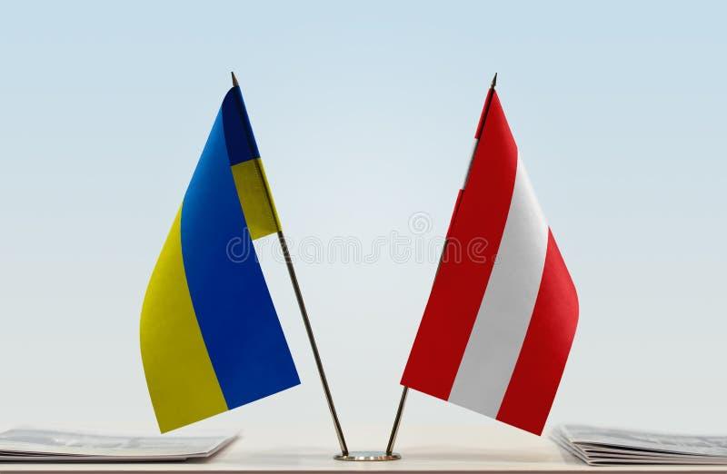 Flags of Ukraine and Austria. Desktop flags of Ukraine and Austria on bright background stock images