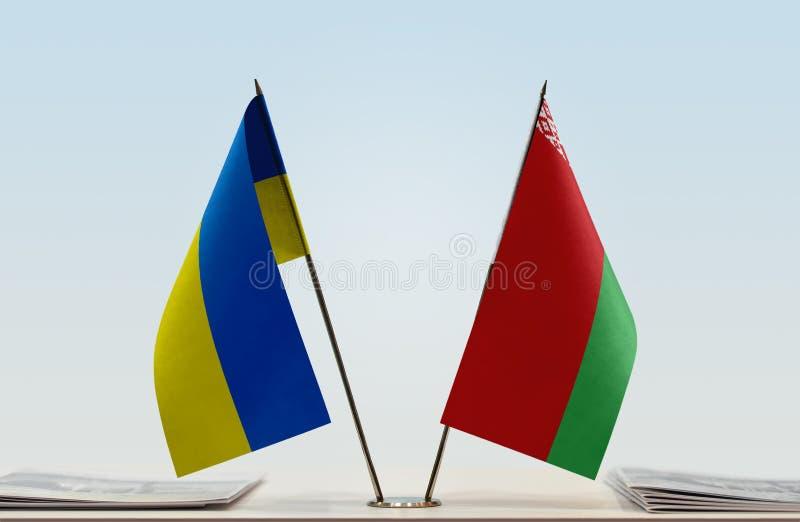 Flags of Ukraine and Belarus. Desktop flags of Ukraine and Belarus on bright background stock images