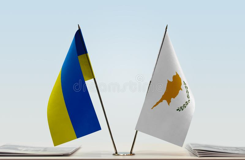 Flags of Ukraine and Cyprus. Desktop flags of Ukraine and Cyprus on bright background stock photos