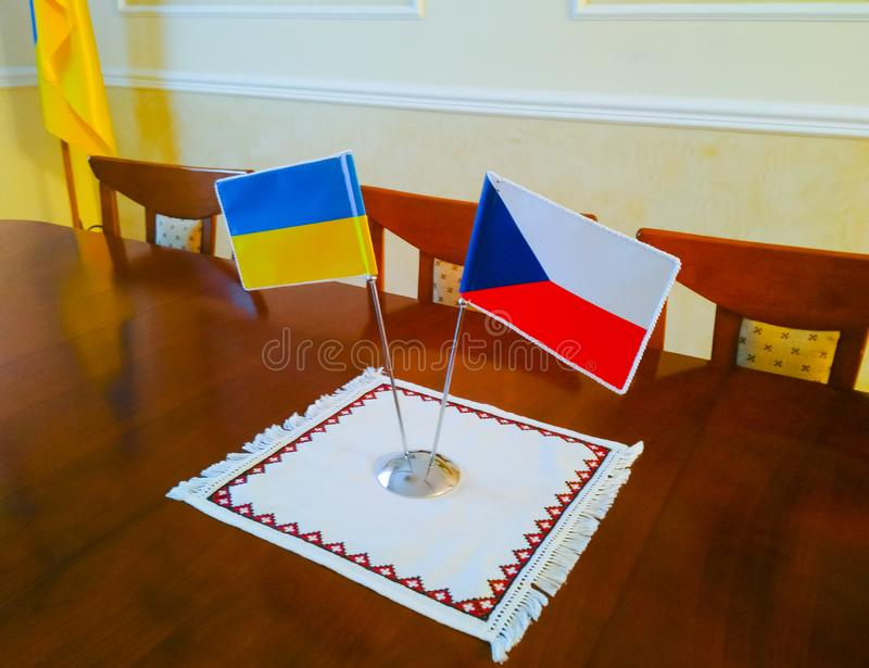 Flags of Ukraine and the Czech Republic on the table stock photography
