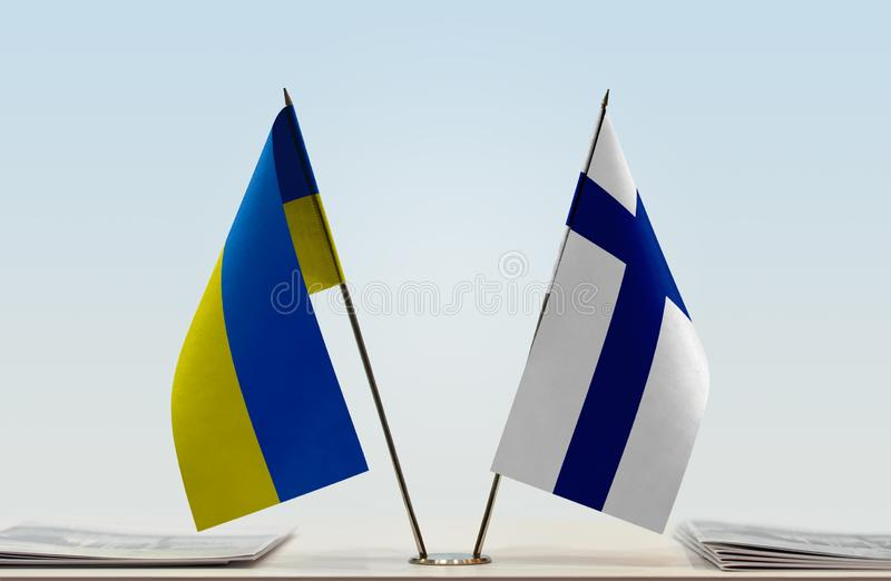 Flags of Ukraine and Finland. Desktop flags of Ukraine and Finland on bright background stock images