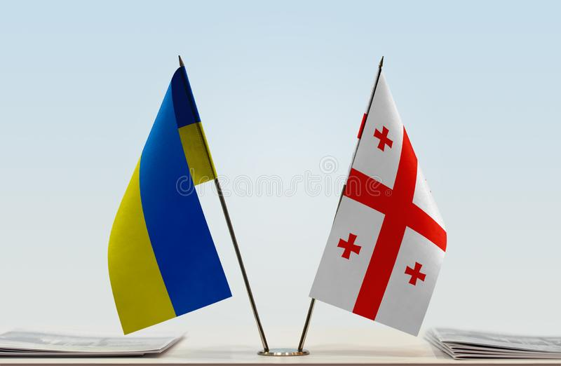 Flags of Ukraine and Georgia. Desktop flags of Ukraine and Georgia on bright background royalty free stock images