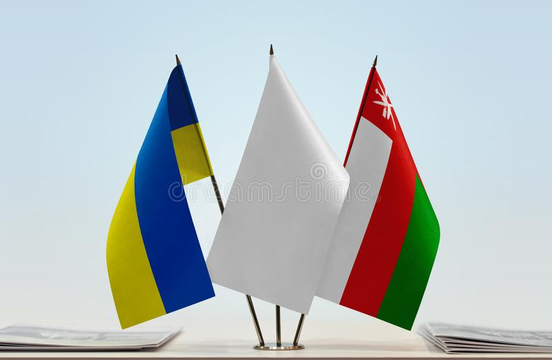 Flags of Ukraine and Oman stock image