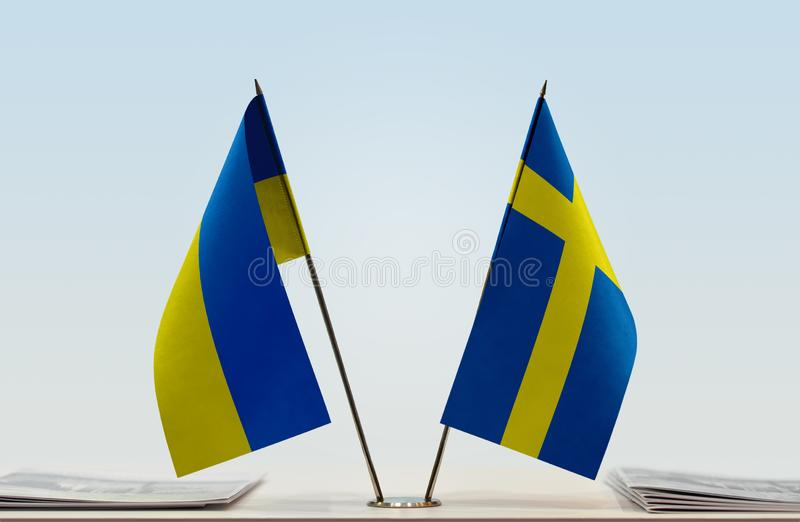 Flags of Ukraine and Sweden. Desktop flags of Ukraine and Sweden on bright background royalty free stock image