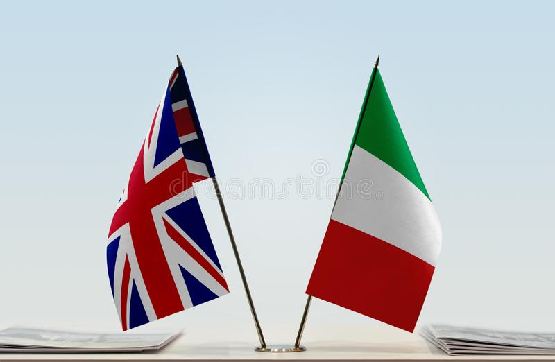 Flags of United Kingdom and Italy. Desktop flags of United Kingdom and Italy on bright background royalty free stock image