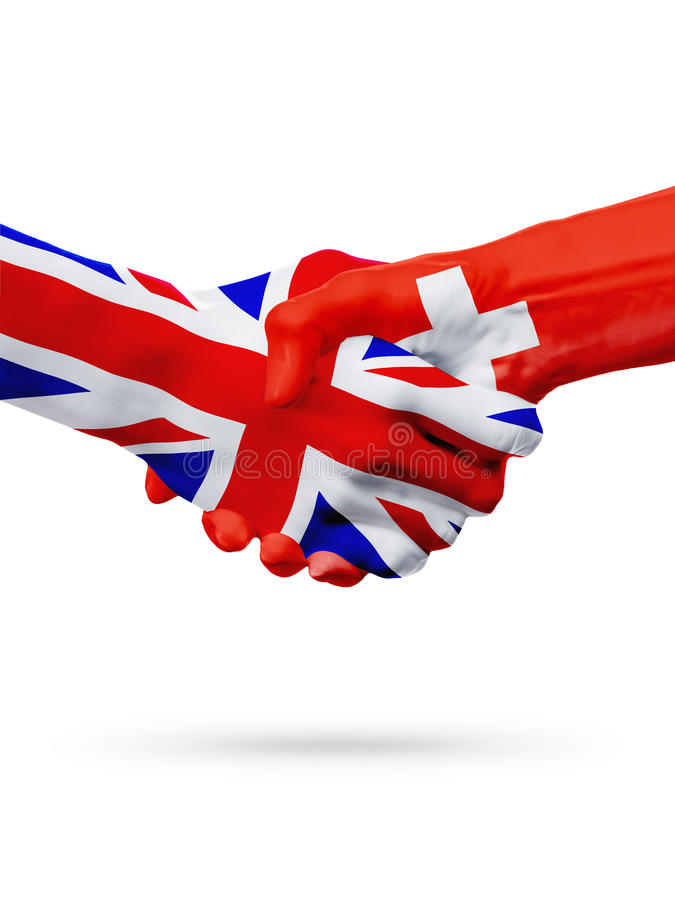 Flags United Kingdom, Switzerland countries, partnership friendship handshake concept. Flags United Kingdom, Switzerland countries, handshake cooperation royalty free stock image