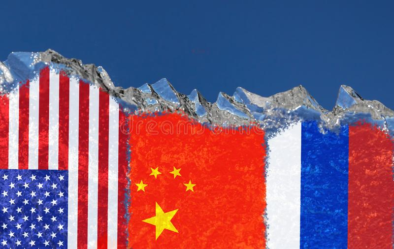 The flags of the United States, China and Russia are narsovany on a piece of ice in the form of an Arctic iceberg against blue sky. The flags of the United royalty free stock photos