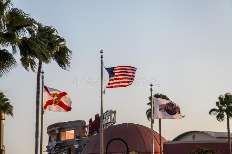 The flags of the United States. Orlando, Florida, USA, September 10, 2019: The flags of the United States of Orlando and Disney are hoisted on the facade of a royalty free stock photography