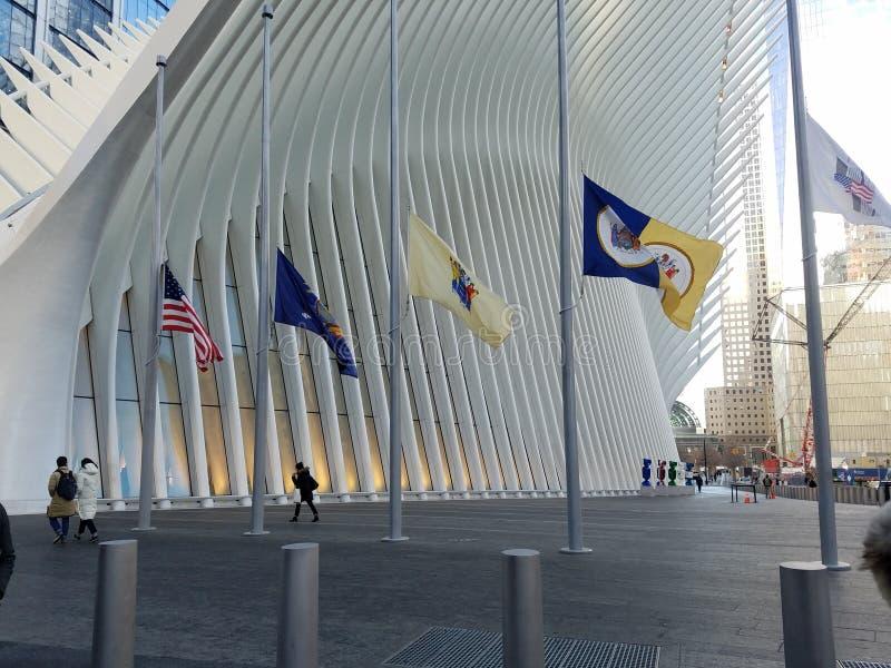 New York, NY / USA - January 14, 2019: Flags at half mast at the World Trade Center Oculus royalty free stock photo