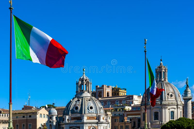 Flags in the wind on Monumento Nazionale a Vittorio Emanuele II stock images