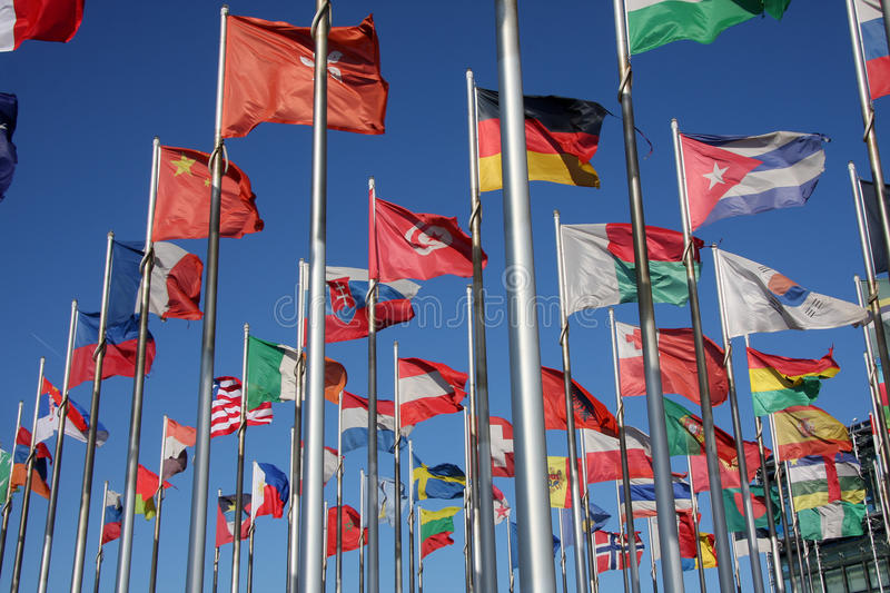 Flags of the world. Happily blowing in the wind stock photos