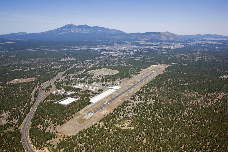 Flagstaff, Arizona Airport. From above with downtown and the San Francisco Peaks in the distance stock photos