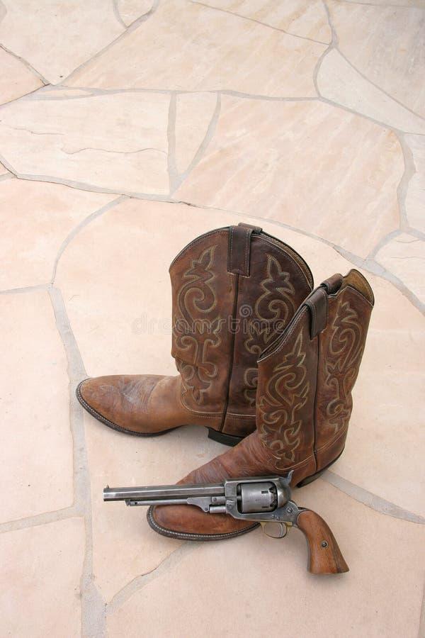 flagstone κάουμποϋ μποτών πυροβόλ&omic στοκ φωτογραφία