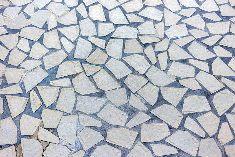 Flagstone footpath. Granite gray flagstone pavement footpath background texture royalty free stock photos