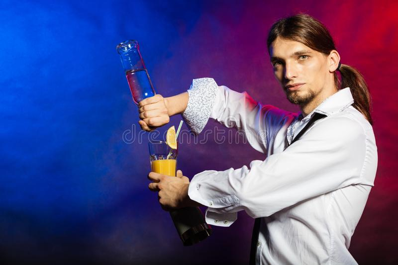 Barman showing his skills. Flair bartending alcohol liquor party concept. Barman showing his skills. Young male tapster makes cocktail royalty free stock photos