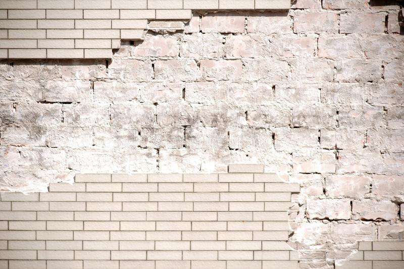 Flaked clinker. The close-up of a house facade with chipped clinker bricks stock image