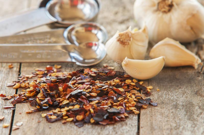 Flakes of red hot chili peppers with garlic stock photo