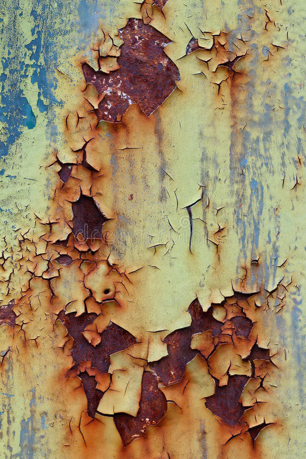 Flaking old and cracked paint from rusty iron. Design flaw royalty free stock images