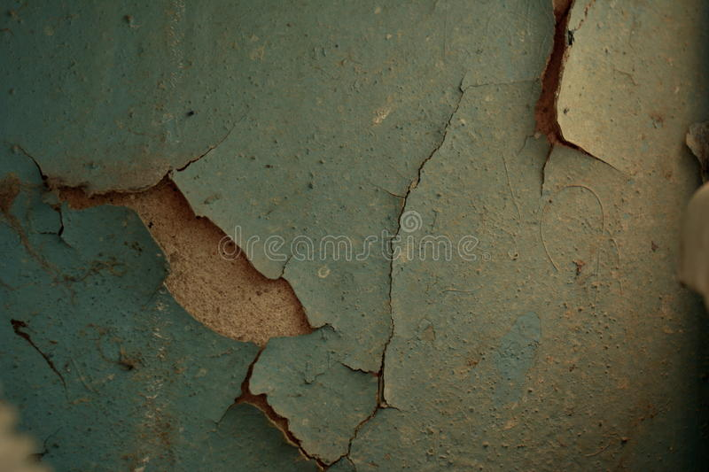 Flaky blue paint on the wall. stock image