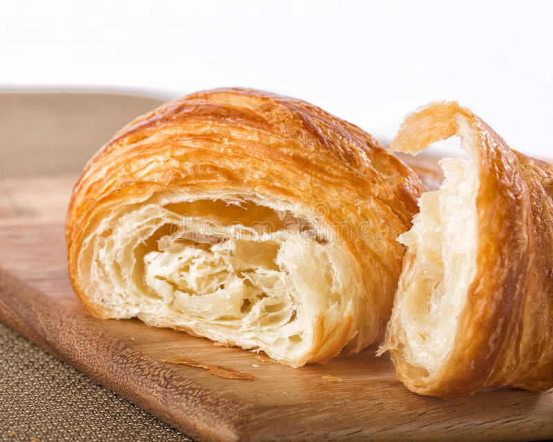 Flaky french croissant pulled apart stock photography