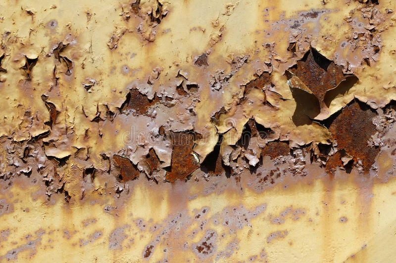 Flaky paint on the old rusty metal stock images