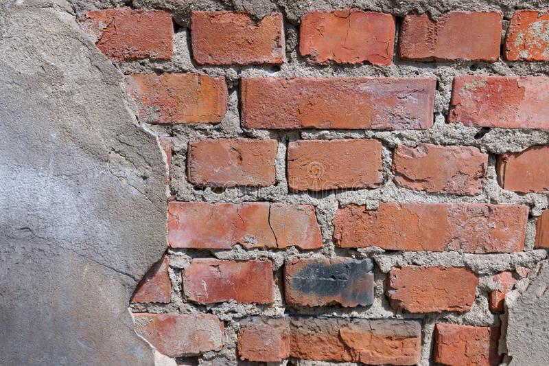 Flaky wall of a city building of red bricks fragment royalty free stock photos