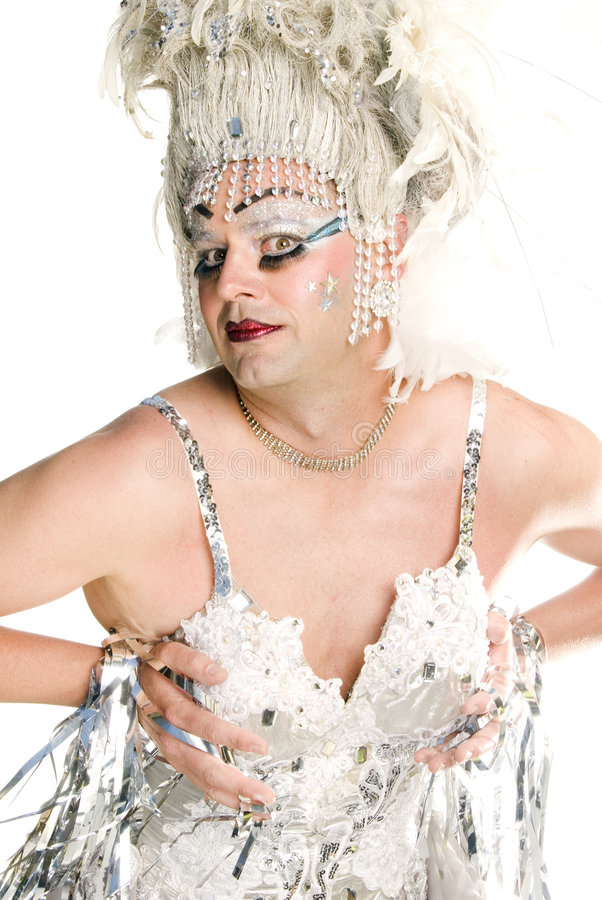 Flamboyant Drag Queen. This image shows a drag queen dressed in a silver outfit stock photos
