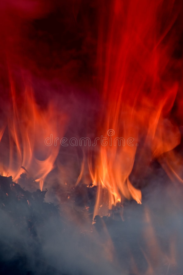 Flame. A photo of bright red flame and smoke