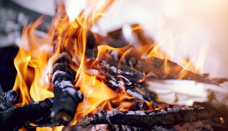 Flame of the bright burning fire. In marching conditions stock photography
