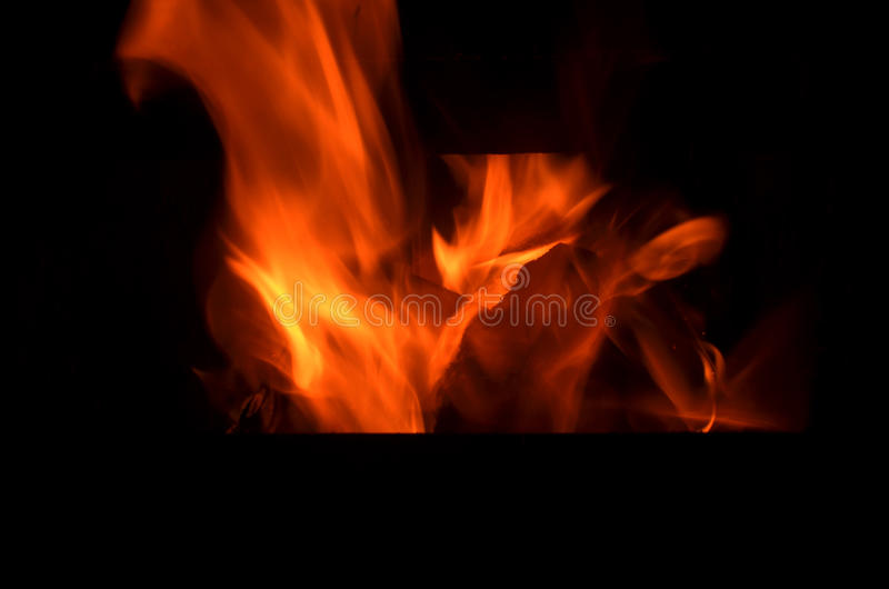 Flame of burning fire for the black background. Outdoor burning fire and smoke royalty free stock photos