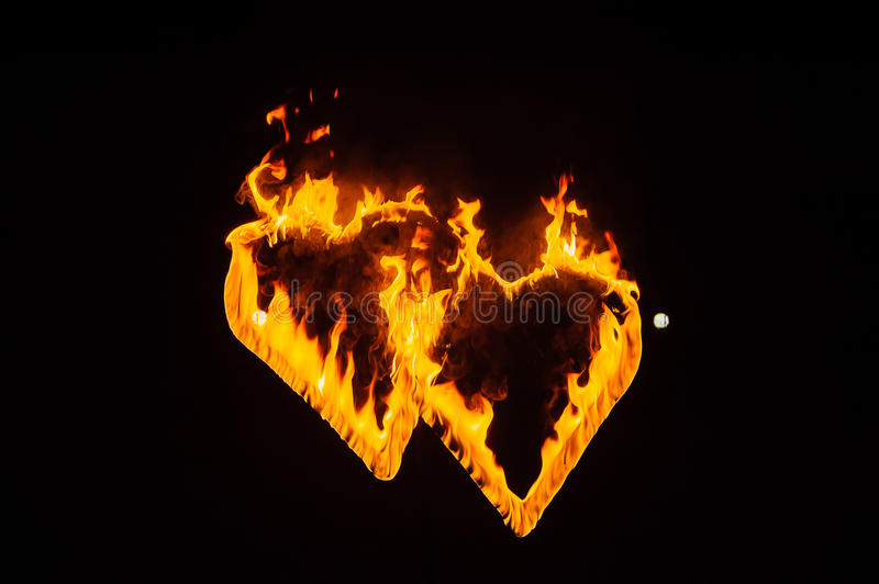 Flame-burning silhouettes of the heart. royalty free stock image