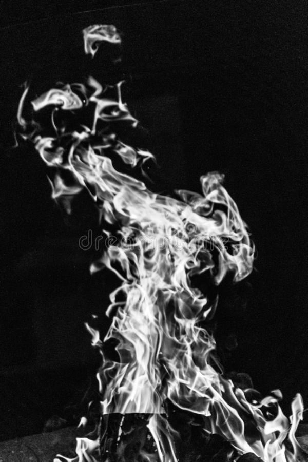 Flame campfire in black and white. Devilish flame. The fire of hell. Background from dancing tongues of fire. Fire hazard. Fire safety. Passionate love. Bask stock image