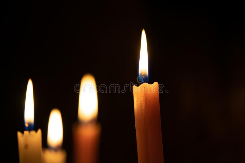 Flame from the candle in the dark room. The light of the means to survive. Or light guide to reach the destination. Light to spark. Creative ideas royalty free stock image