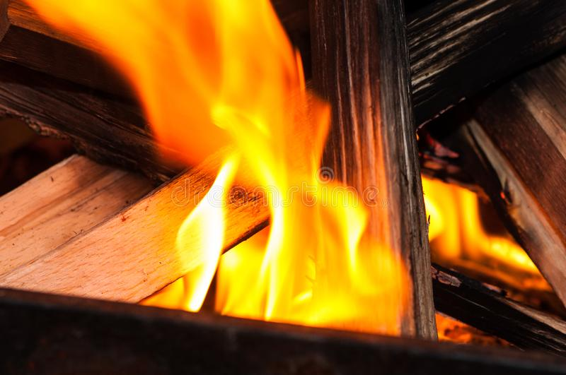 Flame devouring wood sticks. On a coasy fireplace in a hous stock photos