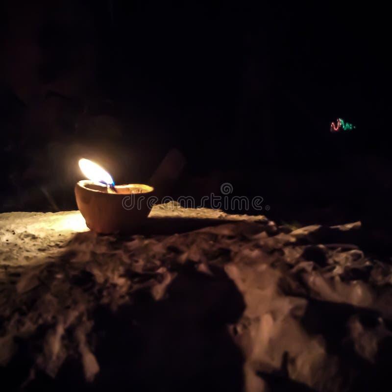 Flame of diya. Fleme of diya on the eve of diwali celebration royalty free stock images