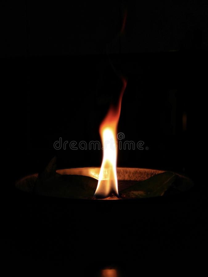 Flame from a diya stock photos