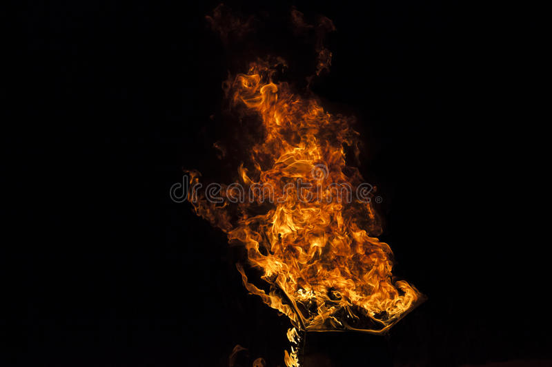 Fire flame on black background stock image