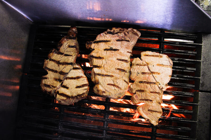 Download Flame Grilled Meat On A Grill Stock Photo - Image of restaurant, barbeque: 22444196