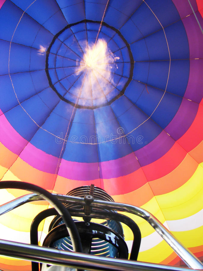 Flame from within a hot air balloon. The flame created from within a rainbow hot air balloon royalty free stock photos