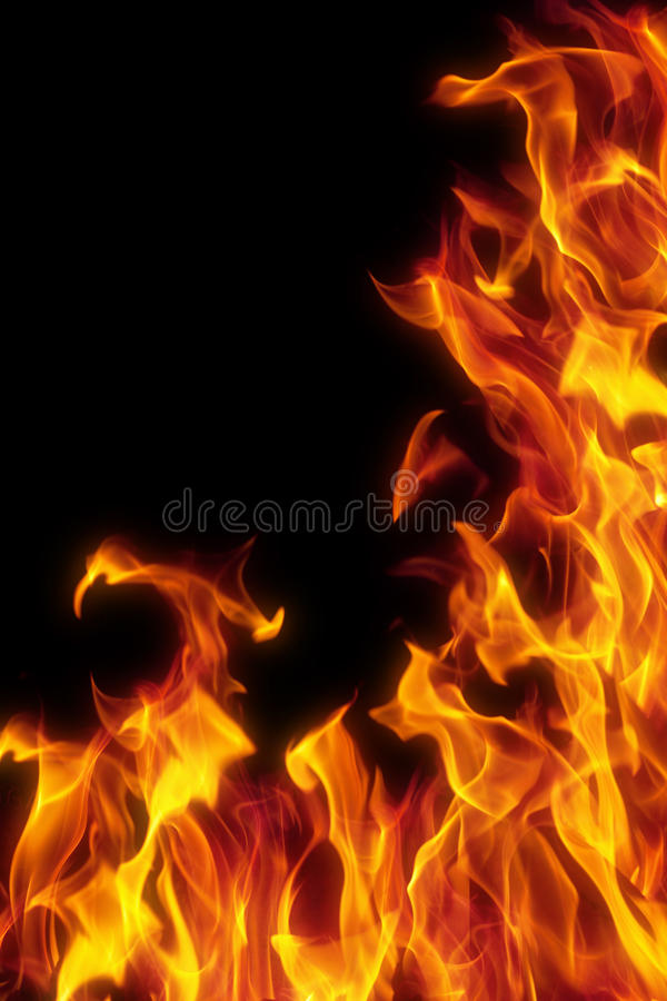 Flame isolated over black background royalty free stock photography