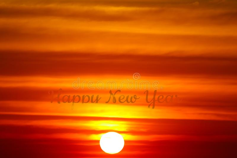 The flame red orange yellow sky silhouette birds flying in sunset back on the cloud royalty free stock image